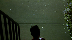 teen on stairs, using cellphone