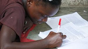Doing Homework, photo by Wikimedia Commons user Alex Proimos