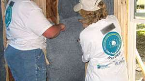 insulation installation, photo by the US Department of Agriculture