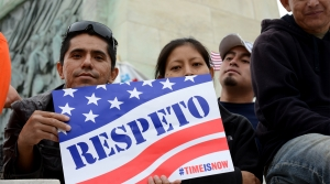 "Latin Americans holding a ""respeto"" sign"