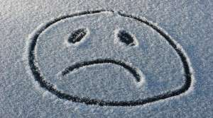 frown face in the snow