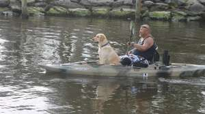 wounded warrior and dog paddling, image courtesy of Rutabaga Paddlesports