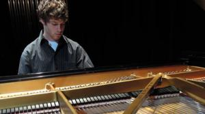 Photo of a young pianist at the keyboard