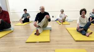 senior citizens practicing yoga