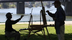 Two people painting