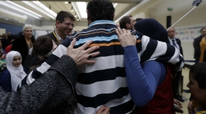 Syrian refugees hug