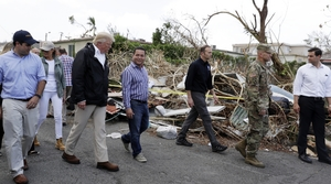 President Trump walks with officials in Puerto Rico surveying damage from Hurricane Maria