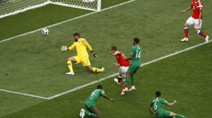 Russia's Denis Cheryshev, center, scores his side's second goal during the group A match between Russia and Saudi Arabia which opens the 2018 soccer World Cup