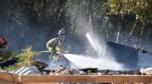 Madison Fire Department firefighters battle a house explosion