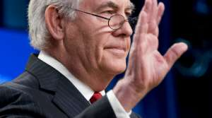 Secretary of State Rex Tillerson waves goodbye