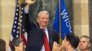 former Wisconsin Gov. Tommy Thompson waves to the crowd