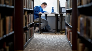 A student studies at St. Norbert College in De Pere.