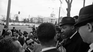 Dr. Martin Luther King Jr. is interviewed on the steps of the Dexter Avenue Baptist Church in Montgomery, Alabama on Feb. 9, 1965, kickoff point for a voter registration march. King had called for 1,000 of his race for the march but only about 200 showed