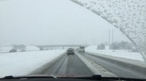 winter highway through windsheild