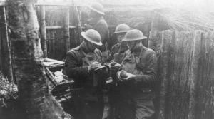 France - Army Reserve Soldiers writing messages for pigeon delivery in the trenches of France, 1918.