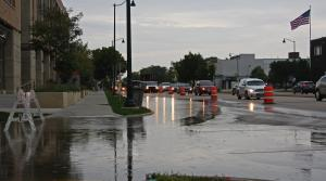 Floodwater seeps onto East Washington Avenue, a main Madison thoroughfare