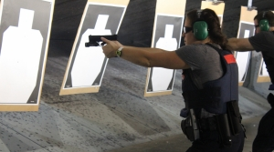 Recruit Jessica Wolf practices shooting at the Madison Police Training Center.