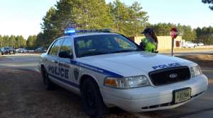 Recruit Stephanie Nelson returns to her squad car during a training exercise.