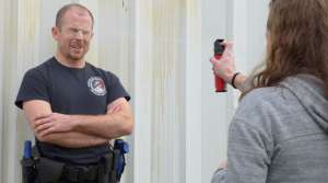 Recruit Nick Cleary is sprayed with pepper spray during training at the Madison Police Training Center.