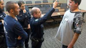 Recruit Nick Cleary practices field sobriety testing on a volunteer who is drunk.