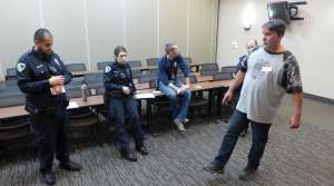 Madison Police recruits Ruben Gonzalez and Brenna Puestow practice field sobriety testing on a volunteer who has been drinking.