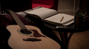 The tools of songwriting - a guitar, paper and pen