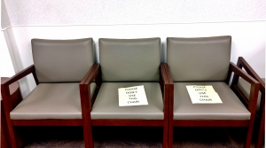 Signs on chairs warning patients to maintain social distancing at one SSM Health clinic on the south side of Madison