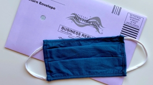 A facemask onto of a mail-in ballot