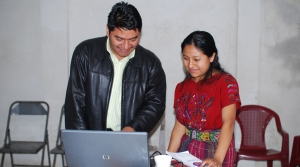 Two people working at a computer