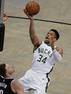 Giannis Antetokounmpo shoots during a playoff game against the Brooklyn Nets