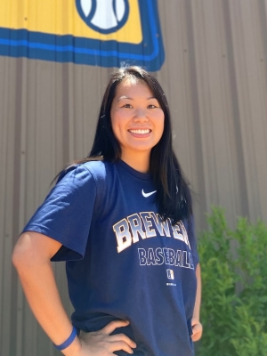 Theresa Lau poses for a photo in Brewers gear