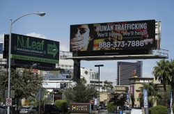 A billboard displays a phone number for the National Human Trafficking Hotline, Thursday, Sept. 21, 2017, in Las Vegas.