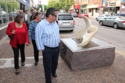 Wisconsin Arts Board Members looking at sculptures on the street in downtown Eau Claire during a visit in 2011