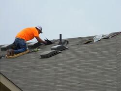 roofer fixing shingles
