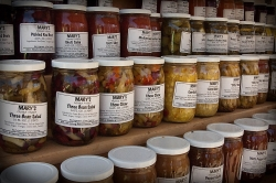 Canned goods at a farmers market.