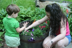 Child gardening with adult