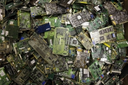 A close-up photo of a pile of circuit boards.