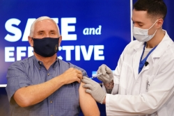 Mike Pence takes COVID-19 vaccine.