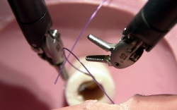 The tiny hands of a surgical robot are used for precision stitching during a demonstration at Maine Medical Center in Portland, Maine.