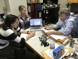 University of Wisconsin-Madison chemistry professor Robert Hamers confers with junior Alice Horein and doctoral candidate Sarah Guillot on their research projects during a meeting in Hamers' campus office.