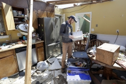 A Chattanooga, Tenn. resident looks to salvage items from a home damaged by tornadoes.