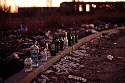 Empty bottles on railroad track