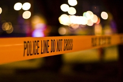 Police tape at a nighttime crime scene