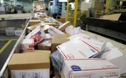 Packages being sorted at postal facility