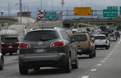 Motorists sit in a traffic backup