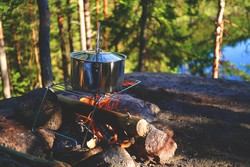 Campfire with cooking pot.