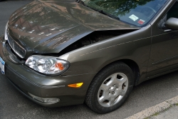 car with dented hood