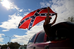 Chance White waves a Confederate battle flag in Oregon