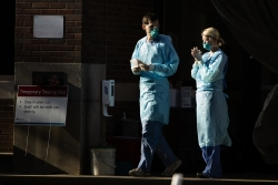 Healthcare workers outside hospital