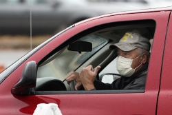 Man in a truck wearing a mask